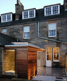 interesting solution tosolid walls with glass pod roof