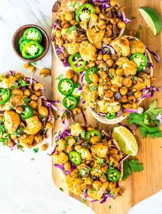 Crispy Roasted Cauliflower Tacos. Low fat, filling, and PACKED with flavor. The filling is so easy. One sheet pan is all you need to make this recipe! {vegan, gluten free, dairy free} @wellplated
