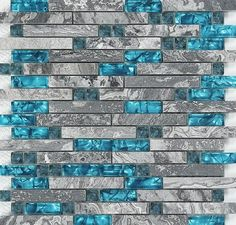 This is our new design marble and glass tile. It is interlocking patterns design with teal blue crystal glass and grey nature marble. The color of the marble chips is random, some chips looks grey and some chips are darker, because they are all made from nature stone, we keep their nature