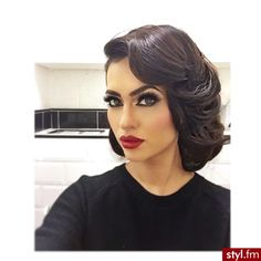 Dramatic make-up, dark eyes & bold lips. Pretty, vintage style hair too.