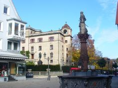 Marktbrunnen, Sigmaringen (Market Fountain).  Market Fountain The fountain was erected 1826 and the figure on it is of Count Johann von Hohenzollern-Sigmaringen. Behind it are the statue of Prince Karl-Anton and Sigmaringen Castle.