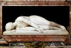 Martyrdom of Saint Cecilia, 1600, marble sculpture by Stefano Maderno (1575-1636). This sculpture marks the gravesite of the rediscovered body of the martyr in 1599. Maderno claims her position in this sculpture mimics the way her corpse was lying in the grave, uncorrupted. She wore a dress and her face was toward the ground. An incision in her neck was visible. She shows signs of forgiveness in her graceful acceptance of reality. - Basilica di Santa Cecilia in Trastevere, Rome, Italy