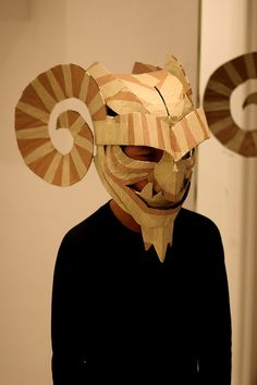 Cardboard gargoyle mask. This is just cool. Might not actually translate to a summer camp activity.