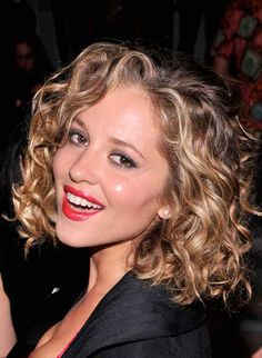 Ashy blonde hair color as ombre balayage looks really adorable on this lightly layered curly bob hairstyle.