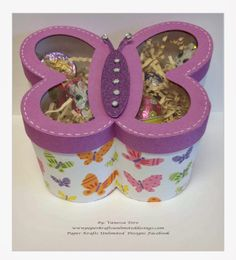 Check out Vanessa's super cute Butterfly-Shaped Box, so fun!  Think of all the fun things you can do with a box like this, use for any occasion, especially for birthdays, Mom would love it!  Wouldn't it be cute made in boyish colors and let them collect bugs!  Hey, that's what boys do, right!  This cute file is in the BUNNY HOP SVG KIT!