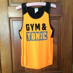 """VS Pink """"Gym & Tonic"""" workout tank Mesh workout top from VS Pink with the saying """"Gym & Tonic"""". Size XS but oversized. Really cute for the gym! NWOT. PINK Victoria's Secret Tops Muscle Tees"""