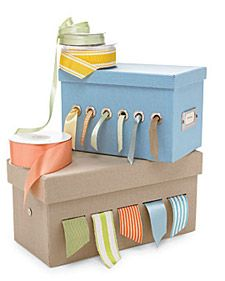 Craft Storage Solutions...love this idea of threading ribbon through colored boxes