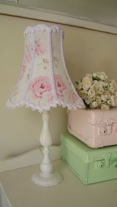 Cute and simple maybe find a lamp and put paper/ material?? Put a string of flowers on stand...?