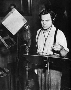 "Halloween Eve, 1938, saw Orson Welles, 23, play a brash radio prank: an hour-long show interrupted by ""news bulletins"" by Martians attacking New Jersey. The broadcast warned four times that it was fiction, a reworking of H.G. Wells's The War of the Worlds; yet police switch-boards were jammed coast-to-coast, and some Princeton profs went hunting for ETs."