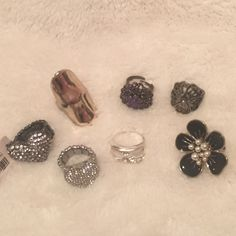 Ring Bundle 7 ring bundle that are either nwt or perfect condition! Buy them all or ask for a price for one or more! 1 gold knuckle ring from Urban outfitters (size large) 2 Aeropostale silver gem heart rings (stretchy) 1 purple and black ring (size 8 + adjustable) 1 silver mask with gems (size 8) 1 silver swirl ring with a flower in the middle (size 8) 1 forever 21 black flower ring with pearls in the middle (size 8) Urban Outfitters Jewelry Rings