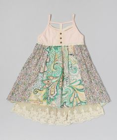 Alternating rows of blooming floral prints lay over a sheer lacy lining to create an enchanting look on this comfy dress. Fit to be twirled, this fanciful frock is topped off with darling lace-trim buttons and waistband.