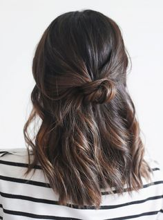 The simple and effortless half-up knot looks great no matter your hair type or length (save for a pixie cut). All you need is a few pins, and a little spray for extra hold. Click here for full...