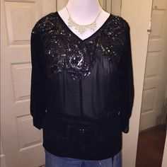 Black with cute accents Love21 sheer black blouse with sequins.. Waist cinched with elastic and with a tie that's seen in. Can dress up or down .. Worn maybe once size M, fits a like large Forever 21 Tops Blouses