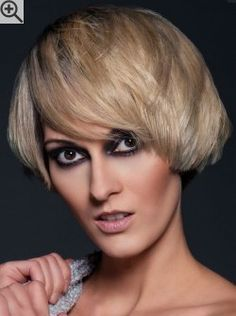 Modern short bob with side bangs for blonde hair with violet hues and dark roots.