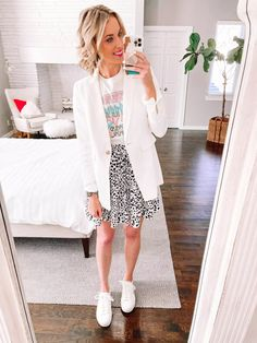 Graphic tee outfit with white blazer, skirt and sneakers. Women's spring outfit How To Wear Sneakers, Skirt And Sneakers, Graphic Tee Outfits, Graphic Tees, White Blazer Outfits, Heavy Jacket, Green Midi Dress, Spring Outfits Women, Green Pants