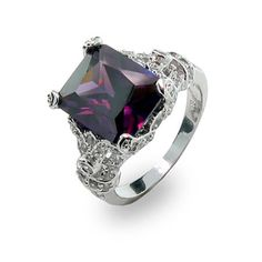 With delicate femininity, this ring takes the eyes on a journey of shimmering beauty. The amethyst cubic zirconia's deep color invites the eyes to gaze deeper into its purple depths as the small white cubic zirconias that flow along the design embrace it.  With a rhodium finish to prevent it from tarnishing and a total carat weight of 10.44 carats, this sterling silver ring is a classy touch to jewelry. Shop with confidence knowing that the quality of our sterling silver cubic zirconia cz…