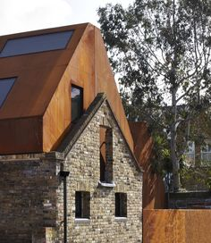 Kew House, Jack Hobhouse, I love the perforated weathering steel cladding and the old brick work. Architecture Renovation, Architecture Old, Residential Architecture, Contemporary Architecture, Habitat Collectif, Steel Cladding, Weathering Steel, Facade House, House Facades