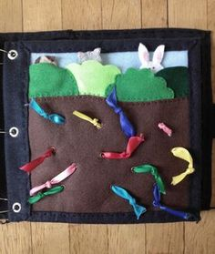 The Quiet Book Blog: Katie's Quiet Book. Colorful worms are ribbon pulls