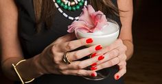 When your dinner party's guest list is a little stuffy, loosen them up with this floral egg white cocktail.