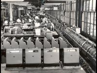 NCR workers assemble electrically powered mechanical cash registers, which were ubiquitous in the supermarkets of the 1950s through the 1970s.