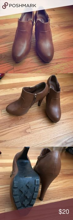 Brown booties Dollhouse brand brown leather ankle heeled booties. Perfect style to pair with a dress or pants. Gold zippers ok both sides of boot. About a 2 inch platform with 3 inch heel.  Lightly worn with a scratch on the toe of right boot Dollhouse Shoes Ankle Boots & Booties