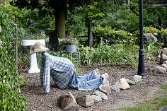 Garden art man weeding.