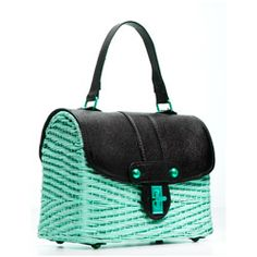 This woven wicker bag, with its black faux-leather trim and turn-lock closure, is just right for an afternoon party. Toss in your keys and a lip gloss and carry it to all those summer baby and bridal showers.