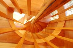 Chiloé wood is technical and material, resulting in a house capable of withstanding inclement weather with a blanket of larch tiles turn creating warm spaces inside with red and yellow woods Ceiling Fan, Tiles, Stairs, Table Lamp, Lighting, Interior, House, Binder, Home Decor