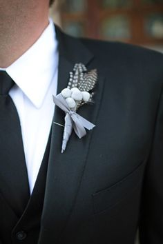 We swoon for a well-groomed gentleman! The suit, the tie and boutonniere are all elements that bring together the big day for the groom-to-be. Wedding Ties, Dallas Wedding, Wedding Groom, Wedding Attire, Wedding Blog, Feather Boutonniere, Boutonnieres, Winter Boutonniere, Gray Weddings
