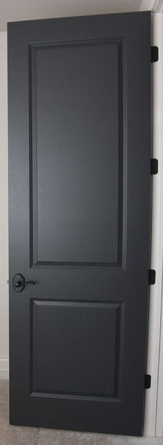 Existing doors refinished in black. This one is a satin sheen which relates a bit to the rustic goals for the house.