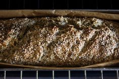 Oat Soda Bread: A rustic oat soda bread you can make in less than an hour. Seriously. Made from a simple ingredient list of rolled oats, flour, baking soda, salt, and buttermilk.  2 cups / 7 oz rolled oats    10 ounces / 285 g / ~2 1/4 cups unbleached all-purpose flour, plus more for dusting and kneading    1 3/4 teaspoons baking soda  1 1/4 teaspoons fine-grain sea salt    1 3/4 cups / 415 ml buttermilk, plus more if needed, and 2T. for brushing    mixed seeds - sesame, caraway, poppy, etc.