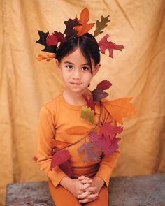 We copied the leaves of maple, oak, ginkgo, sassafras, and birch trees for this autumnal getup, but you can use any leaf shape you wish.