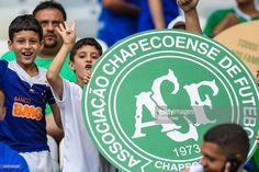 A fan of Cruzeiro pays a tribute for a Chapecoense team during a match between Cruzeiro and Corinthians as part of Brasileirao Series A 2016 at Mineirao stadium on December 11, 2016 in Belo Horizonte, Brazil.