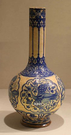 Bottle  Date:     16th century Geography:     Iran Medium:     Stonepaste; painted in blue under a transparent glaze