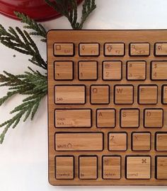 Crafted from bamboo, our Wireless Bamboo Keyboard keeps work stations cheery and cord-free. Bamboo Dishes, Mini Office, Take My Money, Geek Out, Guide Book, Wonderful Things, Cool Gadgets, Keyboard, Gift Guide