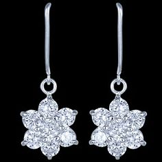 Silver earrings, CZ, flowers Silver earrings, Ag 925/1000 - sterling silver. With stones (CZ - cubic zirconia). Dangle earrings with closable clasp. A flower made of 7 zircons. Diameter of the flower approx. 13mm. Price per pair.