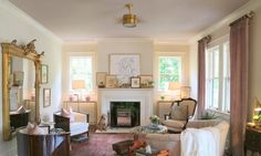 living room walls are Benjamin Moore Albescent OC-40, while the ceiling is Rose Dust 1010.