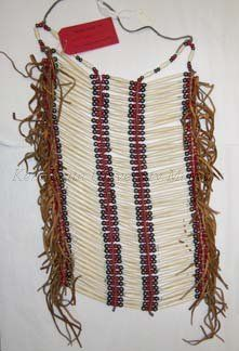 Description20C Native American necklace with 3 rows of bone with brass and red beads on string and leather with leather fringe.  Made by Matt Mesteth of Oglala, Sioux.MaterialBone/Copper Alloy/Beads/Leather