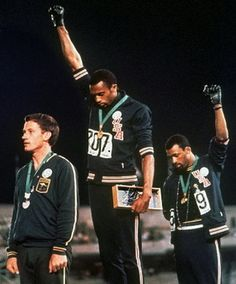 "The black power salute at the 1968 Olympics was a protest made by the African American athletes Tommie Smith and John Carlos; the athletes made the raised fist gesture at the Olympic Stadium in Mexico City. ""The Silent Gesture"" Tommie Smith, Mexico 68, Mexico City, 1968 Olympics, Summer Olympics, Mexico Olympics, Black Power Salute, Foto Sport, American Athletes"