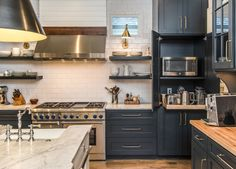 Cape Dutch style home in Tennessee opens to stylish interiors Blue Gray Kitchen Cabinets, Grey Kitchen Island, Black Cabinets, Farmhouse Interior, Modern Farmhouse Kitchens, Home Kitchens, Home Decor Kitchen, New Kitchen, Kitchen Dining
