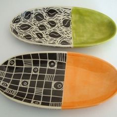 Oval trays with black and white sgraffito desing and a pop of color.