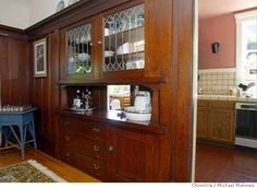 A pass-through china cabinet leading into the kitchen. This would be great in a lighter, more modern design.