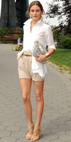 06/28/13: Street style star Olivia Palermo stepped out in New York City wearing a crisp white button-down tucked into a pair of tailored khaki shorts. A pair of nude open-toed booties, a gold skinny belt, gold cuff and a faux python Olivia + Joy purse were the finishing touches. #lookoftheday