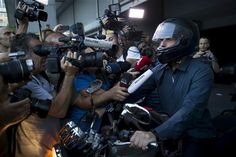Greek Finance Minister Yanis Varoufakis talks to the media as he leaves the Finance Ministry building on his motorbike in Athens, Greece, July REUTERS/Marko Djurica Austerity, Greek, Politics, Marketing, July 1, Athens Greece, Ministry, Helmet, Leaves