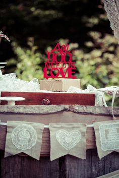 All You Need is Love Cake Topper on Drifted Wood Vintage Wedding Cake Stand