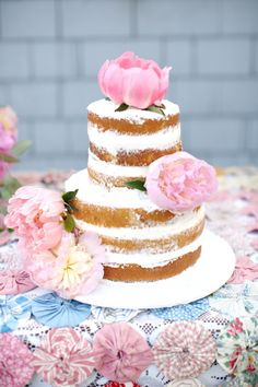 Peony covered naked wedding cake: http://www.stylemepretty.com/little-black-book-blog/2014/08/25/rustic-bohemian-wedding-inspiration/   Photography: Kay English - http://www.kayenglishphotography.com/