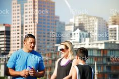 Mixed Race Family in Sunshine in an Urban Scene royalty-free stock photo Kiwiana, Mixed Race, Scene Photo, Sport Casual, Image Now, Sport Outfits, Sunshine, Royalty Free Stock Photos, Racing