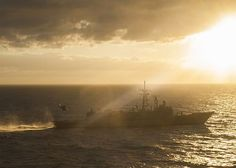 Great Photo! An MH-60S Sea Hawk helicopter delivers cargo to the guided-missile frigate USS Kaufman (FFG 59).