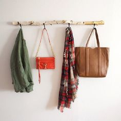 Turn a piece of driftwood into an adorable wall hanger... the perfect place to hang coats, scarves, purses, and more!