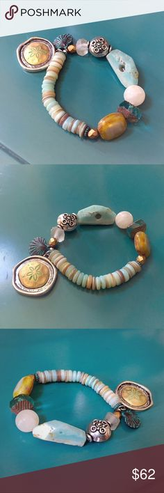 precious gemstone & shell stretch charm bracelet Pretty heishi shell beads are mixed with an assortment of beads including moonstone, amazonite, peweter, copper, czech glass and recycled sea glass. This is a really beachy bohemian bracelet in blue, turquoise, and sea green shades of the ocean. It is stretchy and should fit a 6.5 inch wrist. Jewelry Bracelets
